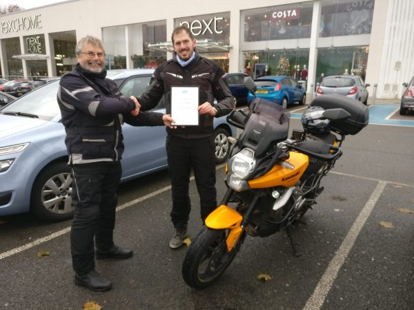 Tom O Rouke passed his test early this year. Here is Chris Longdon presenting his certificate